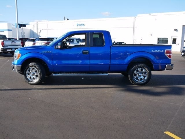 Used 2011 Ford F-150 Lariat with VIN 1FTFX1EFXBFC50807 for sale in Fridley, Minnesota