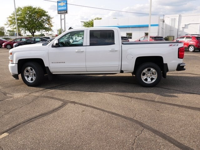 Used 2016 Chevrolet Silverado 1500 LT with VIN 3GCUKREC8GG375966 for sale in Fridley, Minnesota